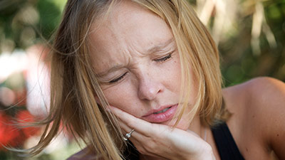 woman suffering from severe toothache