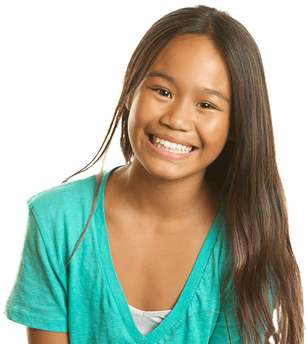 girl in green top, smiling