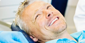 man sitting on dental exam chair