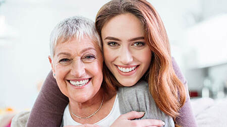 Lake Forest cosmetic dentistry woman hugging her mother