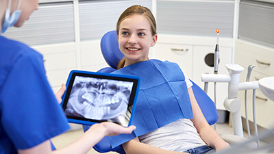 dentist explaining teeth x-ray to dental patient