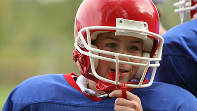 kid wearing football helmet